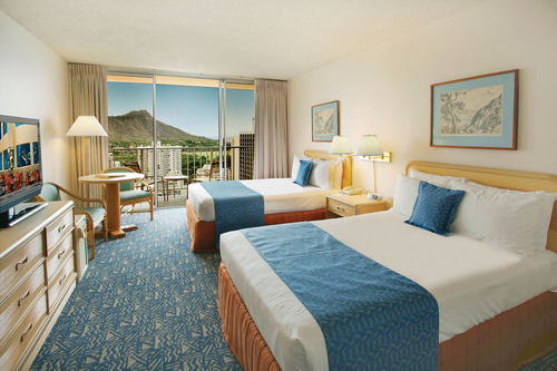 A perfect view of Diamond Head Crater offers a stunning background for guests staying at one of the Pacific ...