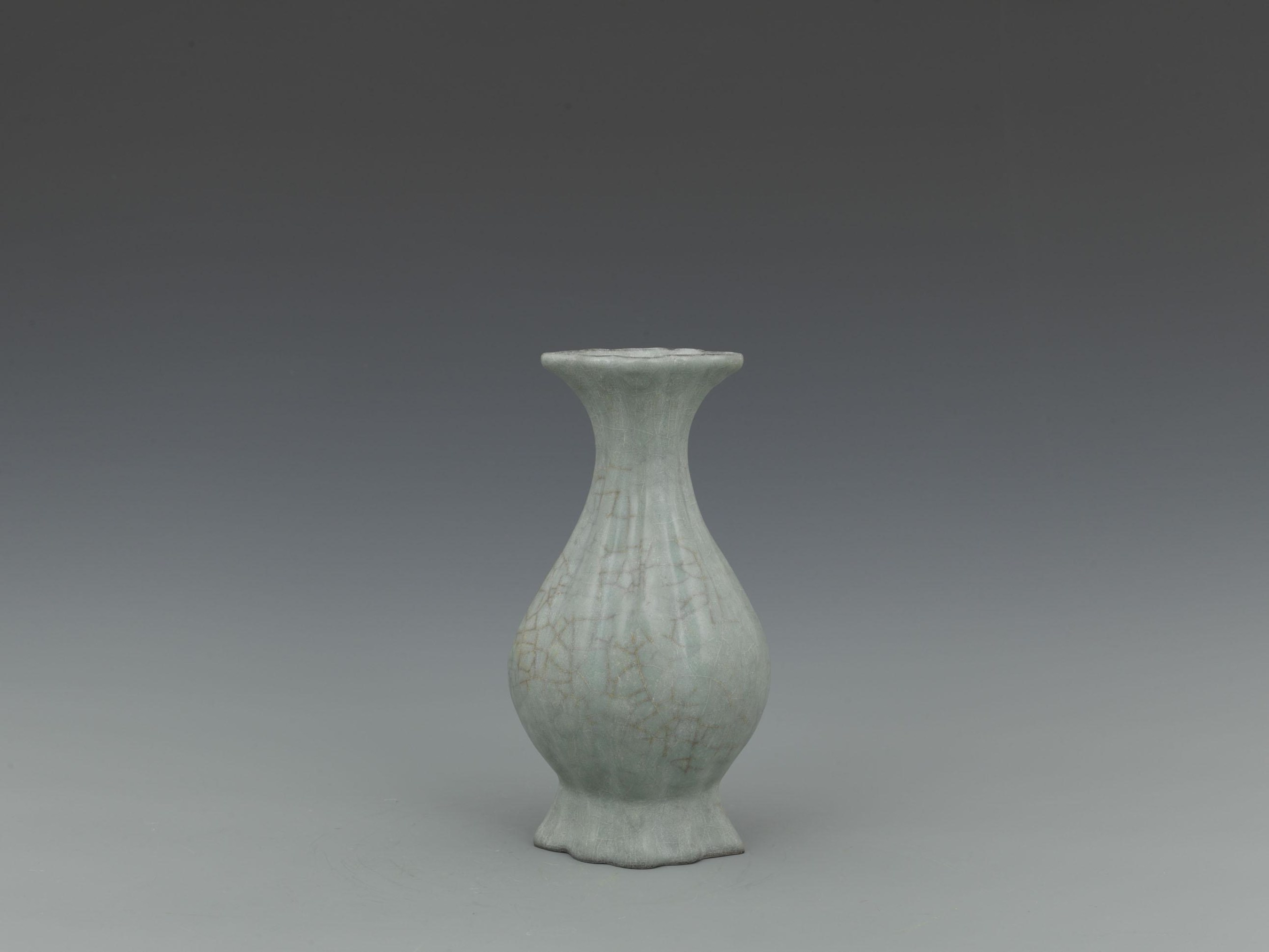 A Celadon Glazed Icy Crackle Bamboo Necked Bottle Vase (Lot Number 1618)