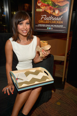 Professional dancer Cheryl Burke celebrates the return of two favorites -- fall television and Wendy's Flatbread Grilled Chicken sandwiches -- at Wendy's Ultimate Premiere Party on September 16, 2013 in Los Angeles. (Photo by Lester Cohen/Getty Images for Wendy's).  (PRNewsFoto/The Wendy's Company)