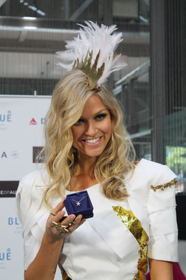 Miss Universe Australia, Renae Ayris, shows off her ILLA Cluster diamond pendant from Hearts On Fire. This was a gift to the current Miss Universe Australia from Hearts On Fire to kick off their sponsorship of the global event beginning in 2013.  (PRNewsFoto/Hearts On Fire)