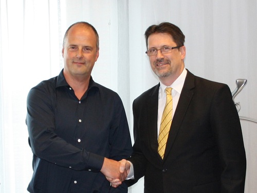 Signed the contract: Erik Scheepers (Founder and CEO Alpha Deuren, left) and Rainer Schackmann (CEO Novoferm, right) (PRNewsFoto/Novoferm)