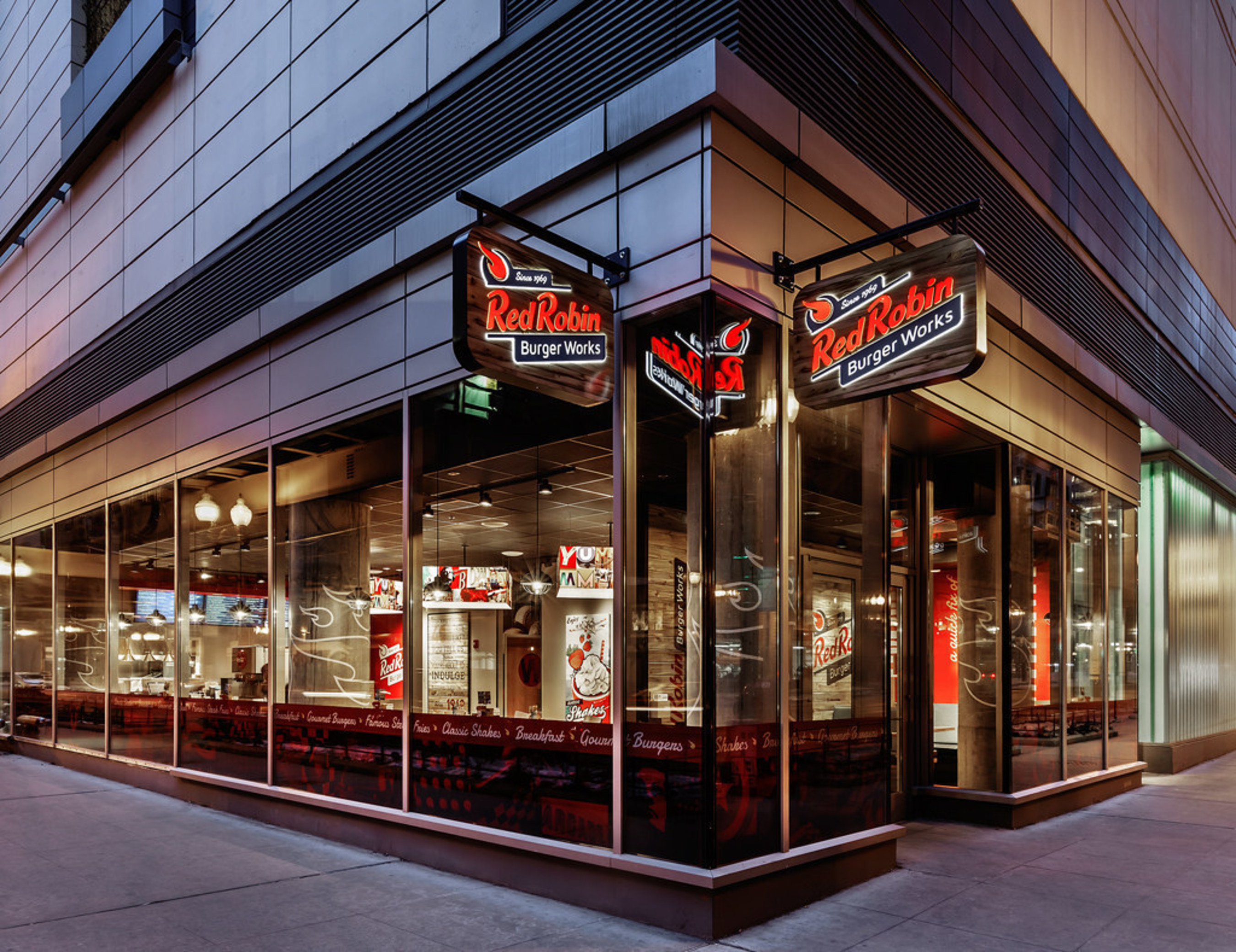 Red Robin Burger Works restaurant exterior. Red Robin Burgers Works is a smaller, fast-casual restaurant prototype operated by Red Robin Gourmet Burgers, Inc. that serves fiery, fresh food with friendly and quick service.
