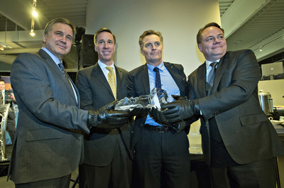 "Don Cleary, President of Marriott Hotels of Canada, Arne Sorenson are presented a ""key"" to the Ice District by Glen Scott, Senior Vice President, Real Estate, Katz Group and Darren Durstling, President, WAM Development Group."