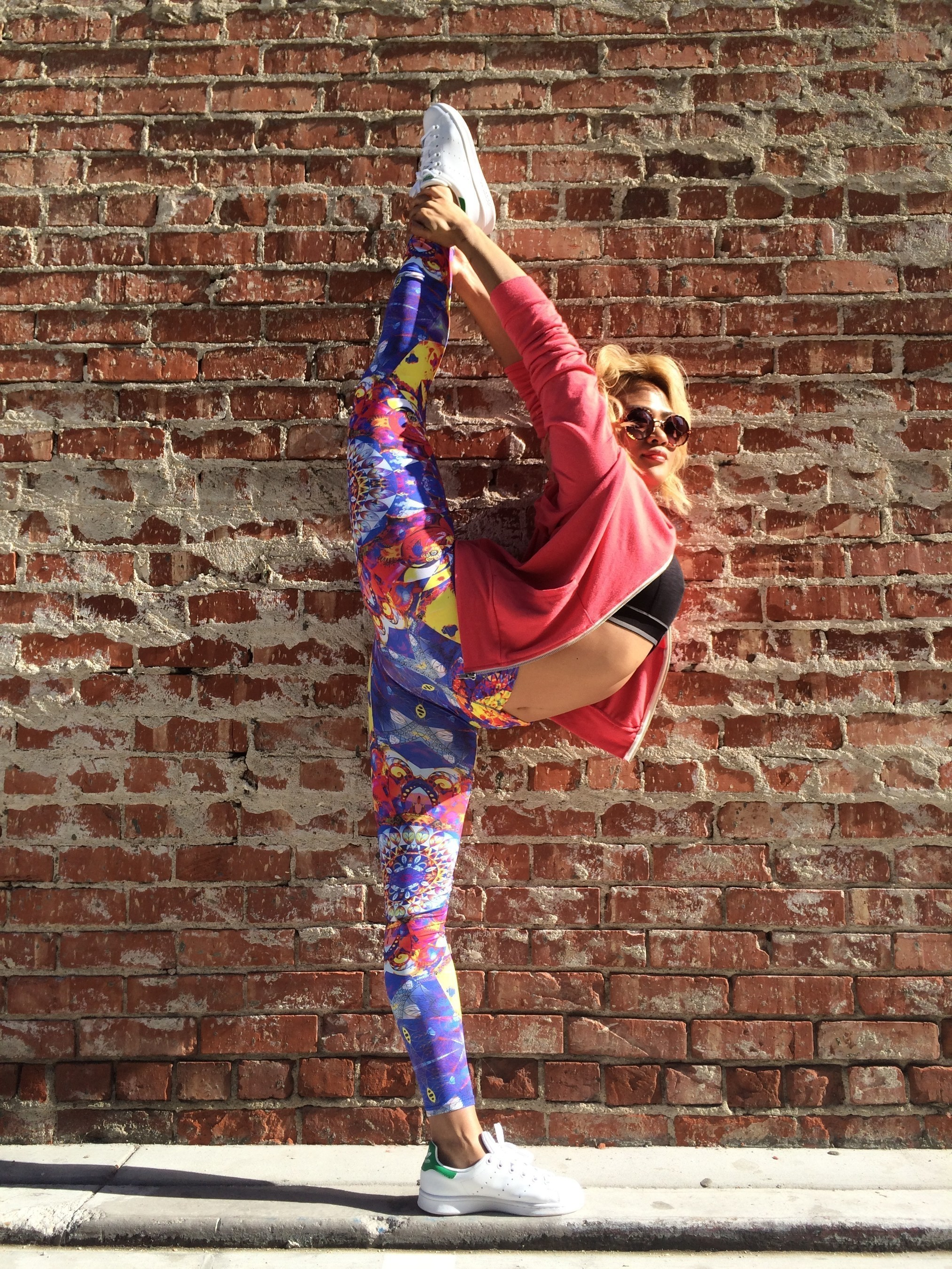 Veronica Lombo, a Bikram certified yoga instructor, modeling Cheribela Temple Leggings in Venice, California.