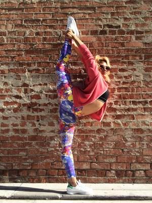 Veronica Lombo, a Bikram certified yoga instructor, modeling Cheribela Temple Leggings in Venice, California.