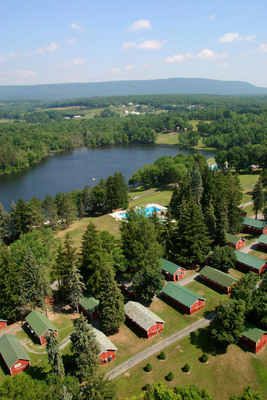 Camp Pocono Trails, a weight loss camp in Reeders, Pennsylvania is situated on 350 private acres with a lake and separate swimming pools for boys and girls. The camp provides an environment where both losing weight and having fun are integral parts of the summer camp experience.  Kids build self-esteem and life-long friendships. (PRNewsFoto/New Image Camps)