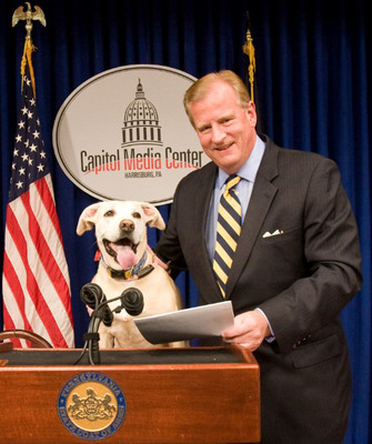 "Rep. John Maher with Humane PA's Brett Miller's dog ""Daisy Mae"" celebrate the passing of a law banning gas chambers in Pennsylvania. Twenty states have so far banned the use of gas chambers as a method of euthanizing dogs and cats.  (PRNewsFoto/Main Line Animal Rescue)"