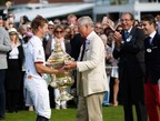 HRH Prince Charles, Prince of Wales awards The Royal Salute Coronation Cup to James Beim of England after the victory in The Royal Salute Coronation Cup at Guards Polo Club in Windsor Great Park on July 25, 2015 in Egham, England.  (Photo by John Phillips/Getty Images for Royal Salute) (PRNewsFoto/Royal Salute)