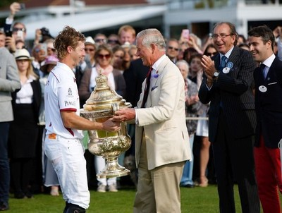 HRH Prince Charles, Prince of Wales awards The Royal Salute Coronation Cup to James Beim of England after the victory in The Royal Salute Coronation Cup at Guards Polo Club in Windsor Great Park on July 25, 2015 in Egham, England. (Photo by John Phillips/Getty Images for Royal Salute) (PRNewsFoto/Royal Salute) (PRNewsFoto/Royal Salute)