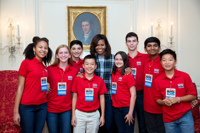 First Lady Michelle Obama joins Scholastic News Kid Reporters for a group photo following an interview in the Map Room of the White House, from left: Adedayo Perkovich, Skylar Yarter, Gabriel Ferris, Maxwell Surprenant, Courtney Pine, Erik Weibel, Manu Onteeru, and Stone Shen, October 6, 2016. (Official White House Photo by Amanda Lucidon)