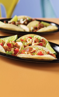 Taco Cabana introduces new grilled ajo chicken street tacos, which are all white-meat chicken, marinated with roasted garlic, onions and rich red peppers, served with shredded lettuce and diced tomatoes, topped with a creamy chipotle sauce.