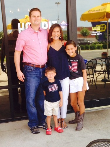 Matthew and Catherine Long with their two children outside Dickey's Barbecue Pit. The family's second ...