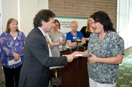 Daniel Straus reached goal of distributing $1 million in Hurricane Sandy relief funds to CareOne employees on May 2, 2013 in Atlantic Highlands, NJ.  (PRNewsFoto/CareOne)