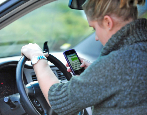 Caution holiday travelers. State Farm survey shows more drivers on the internet.  (PRNewsFoto/State Farm)