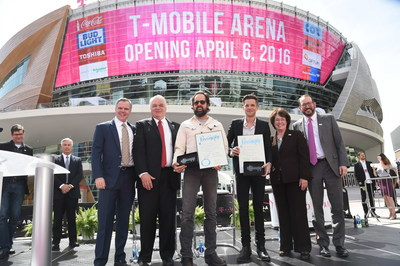 At the grand opening press conference before T-Mobile Arena's first concert, Clark County Commission Chairman Steve Sisolak presented The Killers' Brandon Flowers and Ronnie Vannucci Jr. with keys to the city while proclaiming April 6 to be The Killers Music Appreciation Day. From left to right: Jim Murren (MGM Resorts International Chairman and CEO), Steve Sisolak, Ronnie Vannucci, Jr., Brandon Flowers, Mary Beth Scow (Clark County Commissioner). Photo credit: Ethan Miller / Getty