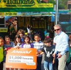 Nathan's Famous representatives presented Gene Slay's Boys' Club with a Schnucks Supermarkets gift card worth $1,000 towards the purchase of groceries, courtesy of Nathan's Famous.