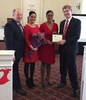 WellCare of New Jersey President John Kirchner (right) presents Krishna Garlic (second from right), the city of Elizabeth's Health and Human Services director, with a WellCare CommUnity Hero Award along with Aviva Woog (second from left), a community advocacy manager for WellCare of New Jersey and Elizabeth Mayor J. Christian Bollwage (left).