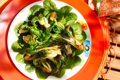 This Asian-inspired recipe is alive with shades of green from spinach and bok choy and distinct flavors of soy sauce, ginger and garlic. Using canola oil to sear the bok choy allows the vegetables to caramelize and soften slightly, while bringing out its natural, subtle sweetness. And when you arrange the sauteed bok choy over fresh spinach, the warmth gently and slightly wilts the spinach leaves. The result is a mouth-watering medley of tastes and textures.