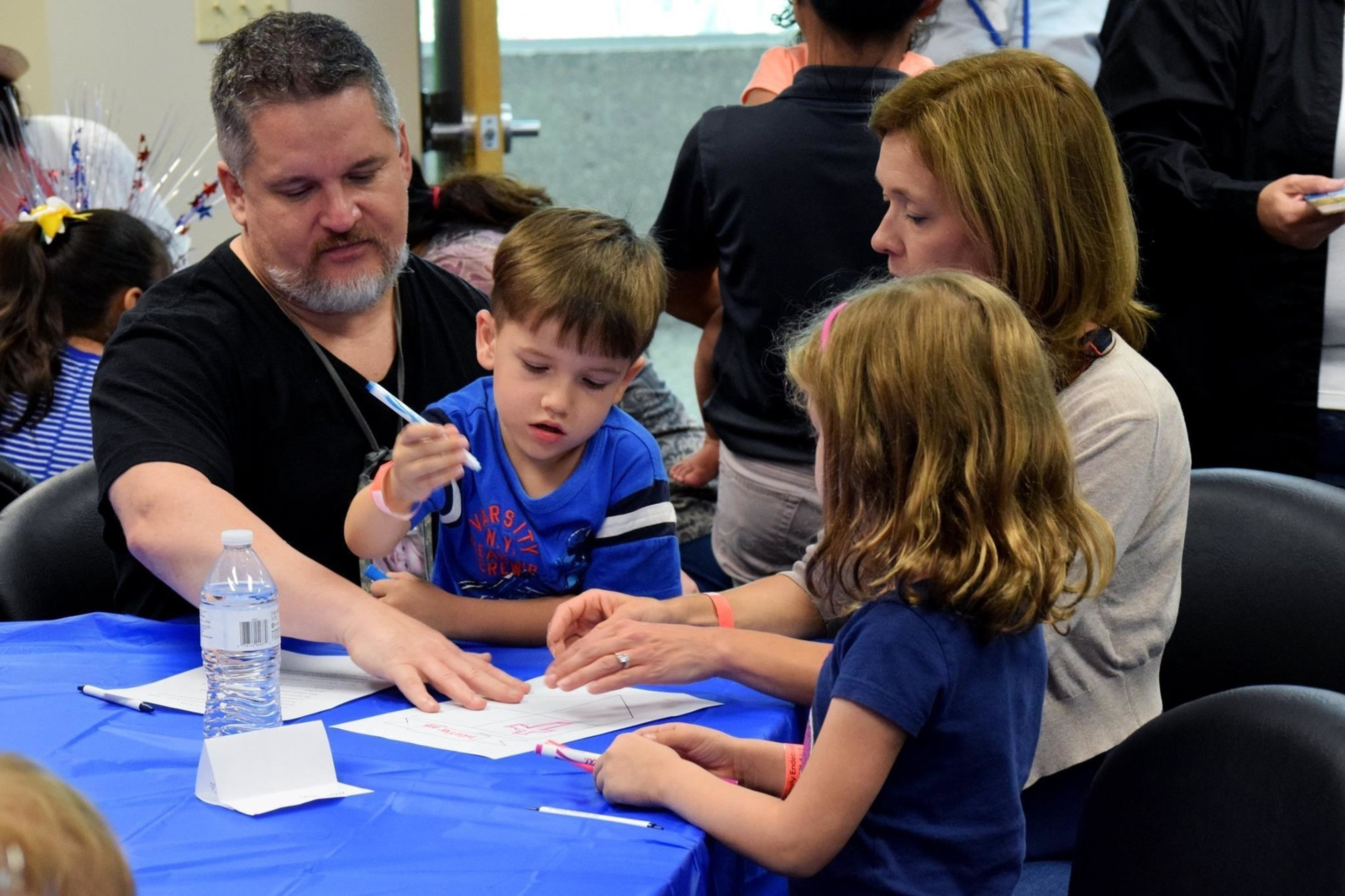 A veteran family designs their family crest during a Wounded Warrior Project event.