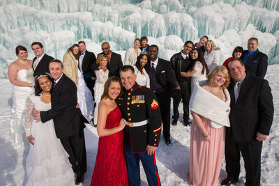 "11 couples say ""I do"" for Valentine's Day at world's largest ""grown"" ice castle at Mall of America.  The couples braved 20 degree temperatures in front of the castle that spans one acre.  (PRNewsFoto/Mall of America)"