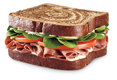 A Steakhouse Roast Beef sandwich on marble rye bread is part of 7-Eleven's new premium sandwich lineup that includes a Bistro Deluxe sandwich with Black Forest ham, Genoa salami and Swiss cheese on Asiago bread.  (PRNewsFoto/7-Eleven, Inc.)