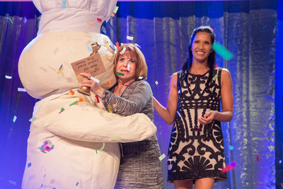 "Million Dollar Moment -- Glori Spriggs receives a hug from the Pillsbury Doughboy(TM) after being named the grand prize winner of the 46th Pillsbury Bake-Off(R) Contest on Monday, November 11, 2013 in Las Vegas. Contest host Padma Lakshmi looks on. Spriggs will appear on ""The Queen Latifah Show"" on Thursday, November 14, 2013. (PRNewsFoto/Pillsbury) (PRNewsFoto/PILLSBURY)"