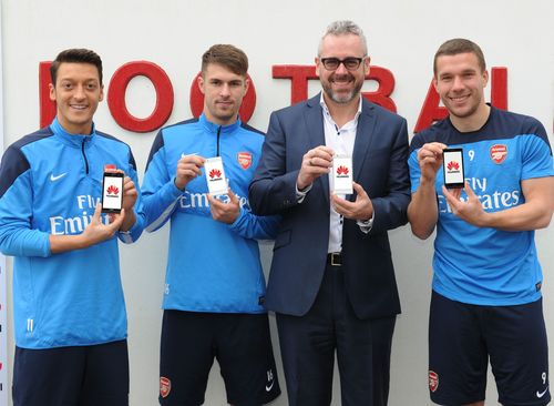 Mesut Ozil, Aaron Ramsey, Mark Mitchinson and Lukas Podolski welcome Huawei as the Official Smartphone Partner of Arsenal Football Club at the Arsenal Training Ground, London Colney (pictured with the Huawei Ascend P6) (PRNewsFoto/Huawei)