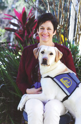 """Facility Dog """"Tibet"""" with Trainer Brenda Kocher.  (PRNewsFoto/Voices for Children of Tampa Bay)"""