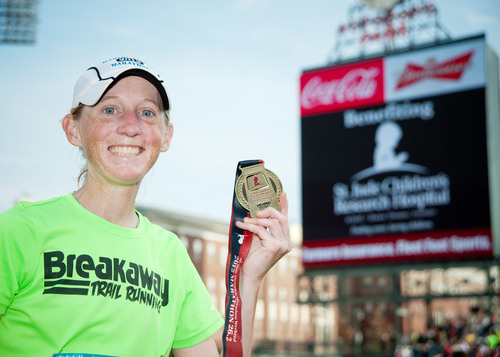 Angie Zinkus of Eads, Tenn. is the top female finisher in the St. Jude Memphis Marathon Weekend presented by ...