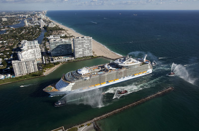 Royal Caribbean International's newest ship, Allure of the Seas, makes her U.S. debut as she arrives into her homeport of Port Everglades in Ft. Lauderdale, Fla. The world's largest and most revolutionary cruise ship comes in five centimeters longer than her sister ship, Oasis of the Seas.  According to Allure's Captain Hernan Zini, the five centimeters represent the ship's new dining including the first Starbucks at sea, entertainment such as the DreamWorks experience, retail offerings and Royal Caribbean's continued commitment to provide its signature Gold Anchor Service. Note: Hi-res images can be found at www.allureoftheseas.com.  (PRNewsFoto/Royal Caribbean Cruises Ltd.)