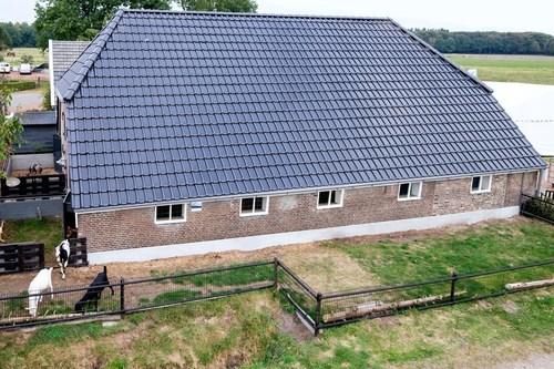 ZEP black solar tiles on the Priesnitzhoeve in Rheden. The Dutch company ZEP made black solar roof tiles,which fulfilled all aesthetic requirements as set out by Dutch governmental law for the use on state protected buildings. (PRNewsFoto/ZEP B.V.)
