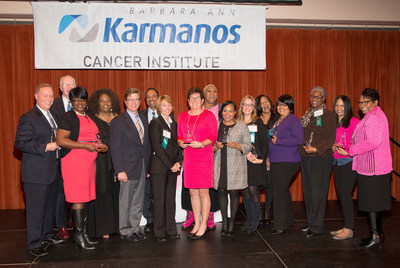 Karmanos Cancer Institute recognized outstanding individuals and organizations at its 22nd annual Heroes of Breast Cancer Awards event, held Oct. 26 in Detroit. More than 200 guests came to celebrate this year's honorees for their demonstrated leadership in raising awareness of breast cancer prevention, early detection, research breakthroughs and inspirational stories. Award representatives included (back L-R) Terry O'Donnell, Frankie Darcell, Manohar Ratnam, Ph.D., Coco, and Angie Starr. Front row (L-R) Paul Pennanen, Malissa Stringer, Gerold Bepler M.D., Amy Weise D.O., Michigan's First Lady Sue Snyder, Fawn Conley, Katie Fehr, Denise Moore, Voncile Brown-Miller, Erika Swilley and Jeanette Girty.