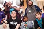 St. Jude patients show off their controller skills to St. Jude PLAY LIVE ambassadors and top-tier gamers,  Man from Man vs. Game, seated, and John from TheSpeedGamers and EatMyDiction1 who cheered on participants