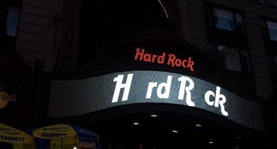 Hard Rock Cafe shows support for the #MissingType campaign by removing the 'A' and 'O' from their iconic Times Square digital sign.