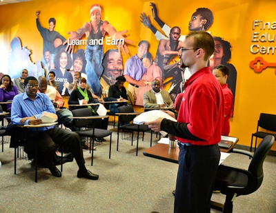 Drake teaching at Key's Financial Education Center in Cleveland, Ohio. Drake oversees the KeyBank Plus program, a suite of non-traditional bank products and services that includes free financial education.