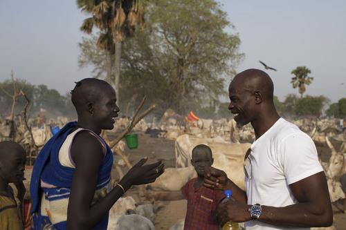 Oxfam America: Djimon Hounsou at a cattle camp near Rumbek, South Sudan. (PRNewsFoto/Oxfam America, Mackenzie ...