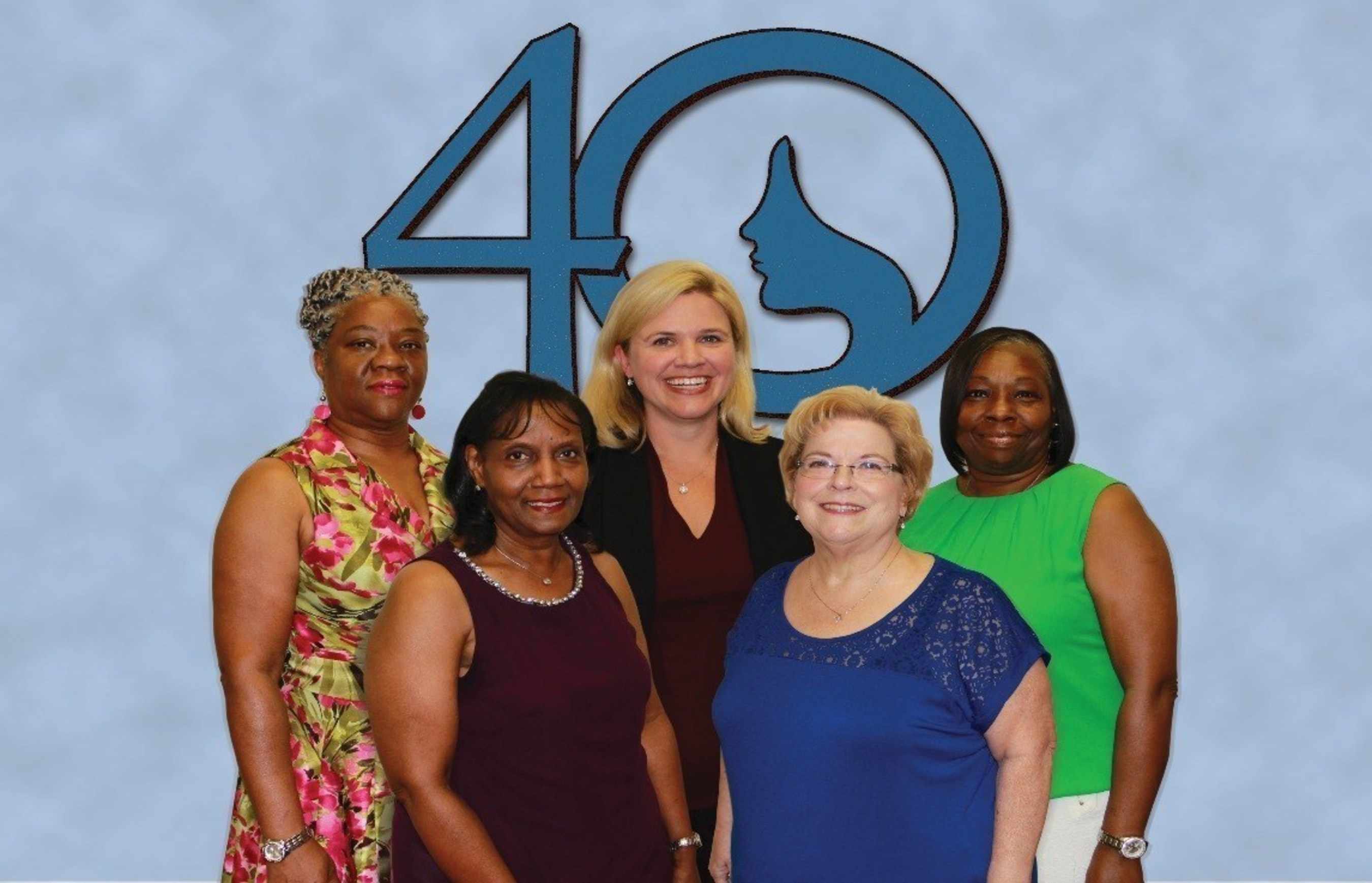 (Back Row, Left to Right) Surgical Technician Bobbie Hall Brown Hall, CEO Ashley McClellan, Labor and Delivery Unit Secretary Katherine Howard, (Front Row, Left To Right) Pre Surgical Testing Nurse Linda Washington, and Operating Room Nurse Carla Tehranchi of The Woman's Hospital of Texas. Ashley McClellan congratulates staff that began their careers at The Woman's Hospital of Texas 40 years ago.