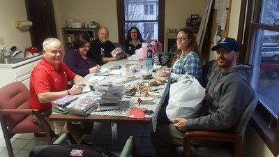 A Wounded Warrior Project Peer Support group prepares ornaments and holiday thank you cards, for Maine Veterans Home.