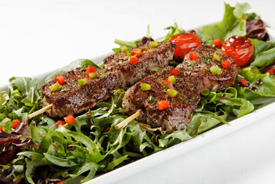 Ruth's Chris Steak House Tenderloin Skewers over Spring Greens.  (PRNewsFoto/Ruth's Chris Steak House)