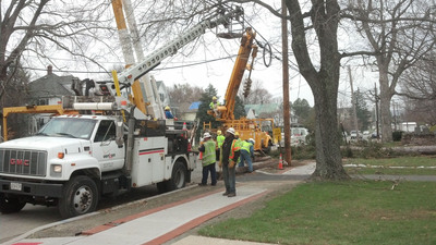 Verizon and power company crews work to replace downed poles in Succasunna, N.J., after Hurricane Sandy.  (PRNewsFoto/Verizon)