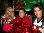 Moses and the Houston Texan Cheerleaders. (PRNewsFoto/Kids Wish Network)