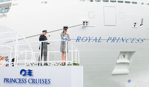 Her Royal Highness The Duchess of Cambridge cuts the ribbon to release the bottle of champagne to officially ...