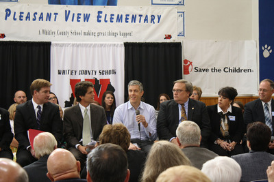 Secretary of Education Arne Duncan (with mic) at an early learning town hall at Pleasant View Elementary School In Williamsburg, KY. He is flanked by Save the Children Senior Vice President Mark Shriver (left) and Senator Robert Stivers (R-25), President of the Kentucky State Senate (right). (PRNewsFoto/Save the Children) (PRNewsFoto/SAVE THE CHILDREN)