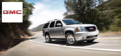 The 2014 GMC Yukon is capable of seating nine, or providing roughly 108 cubic feet of storage space.  (PRNewsFoto/Briggs Auto Group)