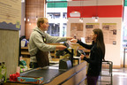 CLE student Thomas Schrank assists a customer at Dawson's Market in Rockville, Maryland.  (PRNewsFoto/College Living Experience (CLE))