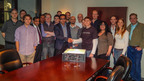 The CoinTerra team handing over the first production TerraMiner IV Bitcoin miner to a retail customer. (PRNewsFoto/CoinTerra) (PRNewsFoto/COINTERRA)