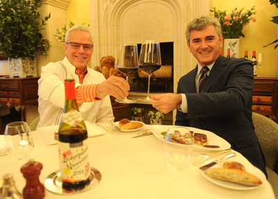 Franck Duboeuf, right, and chef David Bouley celebrate the arrival of the 2014 Georges Duboeuf Beaujolais Nouveau in the U.S., Wednesday, Nov. 19, 2014, at Bouley in New York.  According to French law, the wine is released on the third Thursday of each November.  (Photo by Diane Bondareff/Invision for Les Vins Georges Duboeuf)