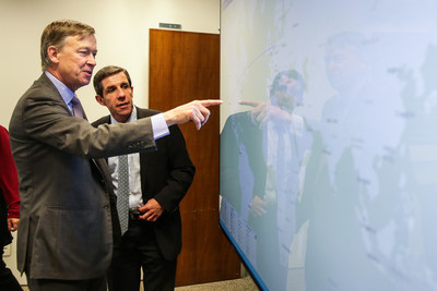 Colorado Governor Hickenlooper and Gabriel del Campo, Level 3, take in a real-time threat map in Level 3's São Paulo Security Operations Center.