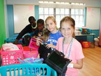 Youth in First Presbyterian Church of Fort Lauderdale's Children's Ministry Fill Backpacks for Charity. (PRNewsFoto/First Presbyterian Church of...)