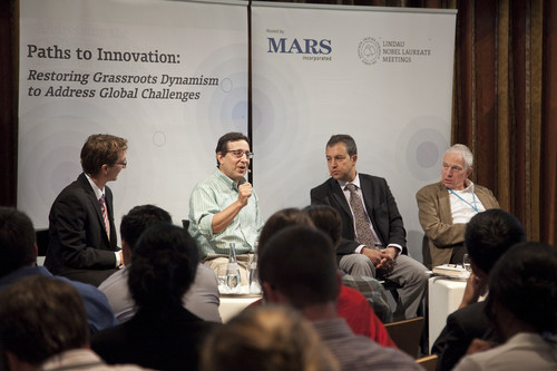 Mars, Incorporated Vice President of Corporate Innovation Ralph Jerome (second from left), speaks about challenges faced by the food and agriculture industry to feed a growing population at the 5th Lindau Meeting on Economic Sciences in Lindau, Germany on Aug. 21, 2014. The Mars-sponsored event brought 120 Lindau young economists together to discuss how to overturn blocks to implementing innovation. Also pictured, from left, are Francois Koulischer, Lindau Young Economist; University Libre de Bruxelles; Romesh Vaitilingam, Moderator, ...